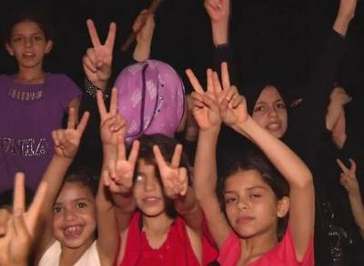 News video: Men, Women and Children Celebrate Gaza Ceasefire